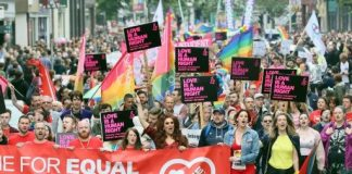 Gay rights campaigners march through Belfast July, 2017 to protest a ban on same-sex marriage
