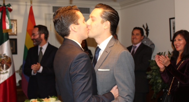 Gay couple making out at the office